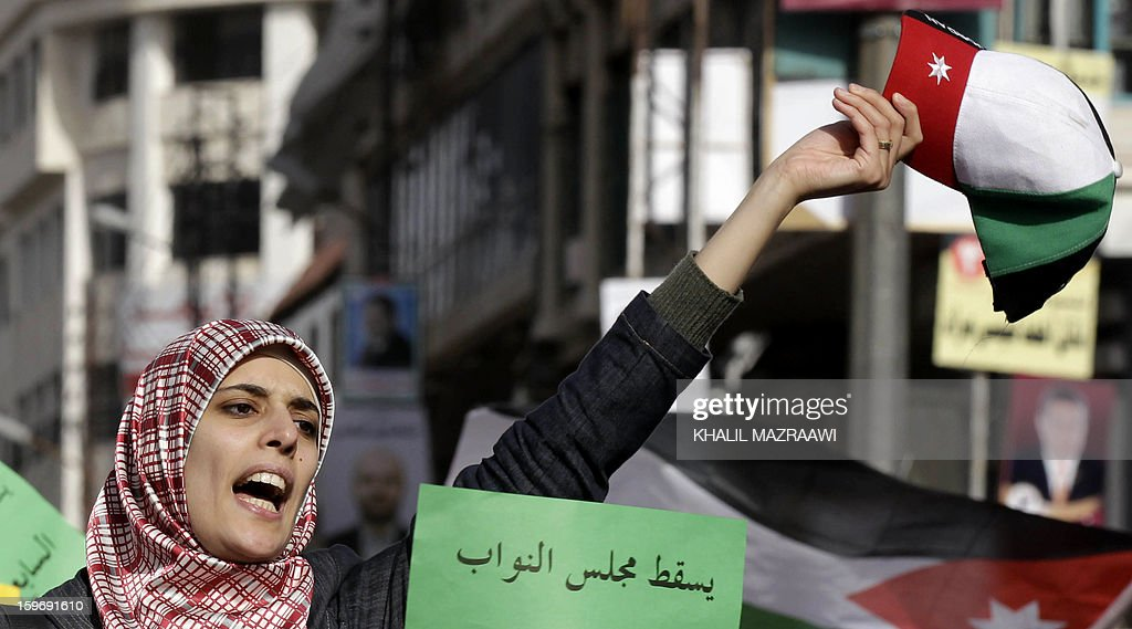 Protesters from the Islamic Action Front and other opposition parties shout slogans during a protest in Amman on January 18, 2013. Some 2,000 protesters including Islamists, youths and leftists held a sit-in the Jordanian capital, rejecting as 'cosmetic' a general election due to be staged next week.