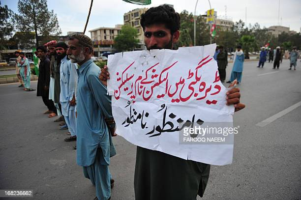Protesters from the Pakistani Bugti tribe marche towards constitution avenue in Islamabad on May 7 2013 Around 300 Bugti tribesmen marched demanding...