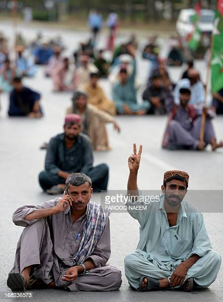 Protesters from the Pakistani Bugti tribe sit on constitution avenue during a protest in Islamabad on May 7 2013 Around 300 Bugti tribesmen marched...
