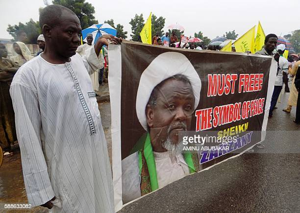 Protesters from the proIranian Islamic Movement in Nigeria holds a banner with a photograph of detained leader Ibrahim Zakzaky to press for his...