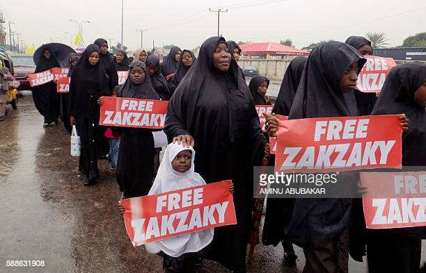 Protesters from the proIranian Islamic Movement in Nigeria march in the rain through the streets to press for the release of their leader Ibrahim...