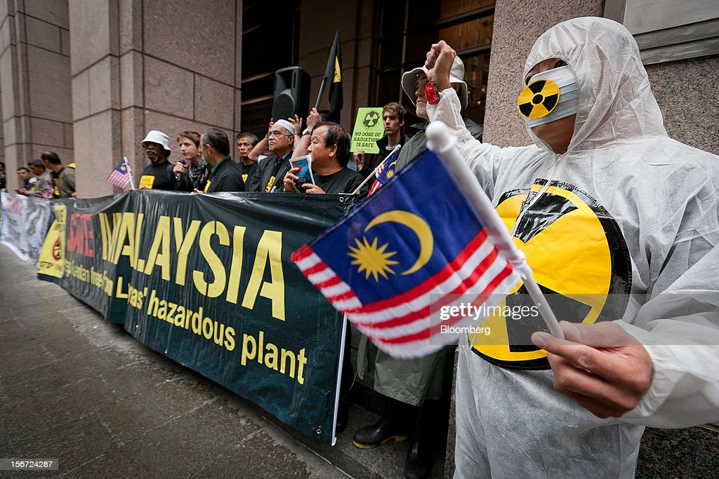 Protesters from the Save Malaysia Stop Lynas group demonstrate outside the Sofitel Sydney Wentworth hotel, the venue for Lynas Corp.'s annual general meeting, in Sydney, Australia, on Tuesday, Nov. 20, 2012. The Save Malaysia Stop Lynas group will appeal a decision by the Kuantan High Court in the Malaysian state of Pahang, where Lynas's rare-earth refinery is located, that rejected an application for an injunction against the company's temporary operating license. Photographer: Ian Waldie/Bloomberg via Getty Images