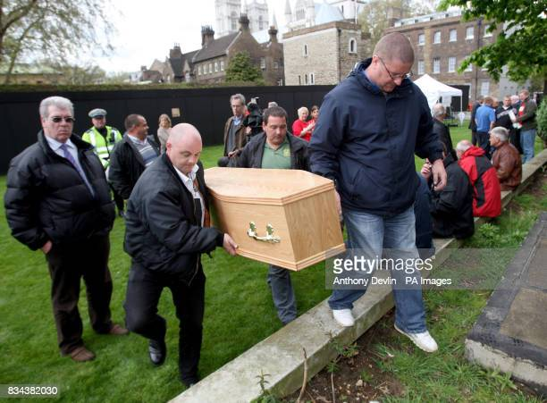 Protesters from the Transaction 2007 protest group carry a coffin outside the Houses of Parliament London as part of a protest against recordhigh...