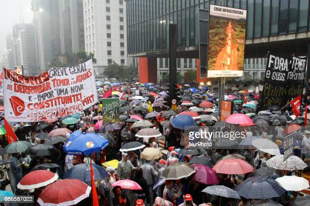 Protesters from various social movements and unions protest in front of the São Paulo Museum of Art on Avenida Paulista in São Paulo on May 21 to...