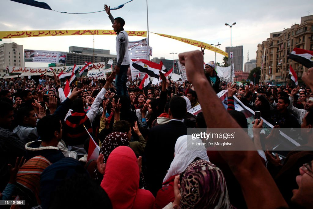 Protesters gather and shout slogans in Tahrir Square on November 27 2011 in Cairo Egypt Thousands of Egyptians are continuing to occupy Tahrir Square...