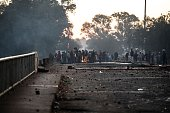 Protesters gather around a bonfire on a bridge on July 21 2016 in Meyerton during a service delivery protest ahead of the August 3rd municipal...