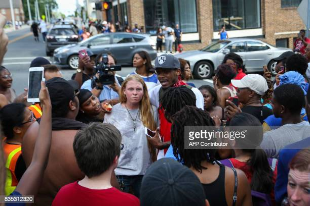 Protesters gather around a woman who is upset that the Confederate Soldiers Monument was toppled days before in front of the old Durham County...