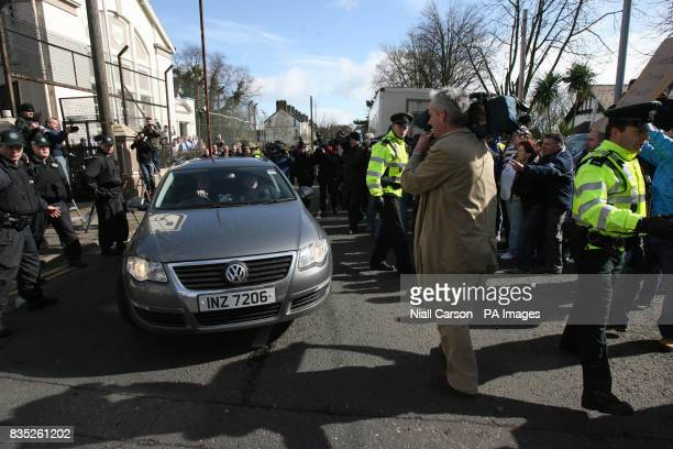 Protesters gather around the police car carrying the high profile republican Colin Duffy as he is taken away from Larne Court House He has been...