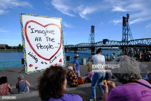 Protesters gather at a rally on the waterfront in Portland Ore United States on August 18 to show solidarity against hate with Charlottesville Va one...