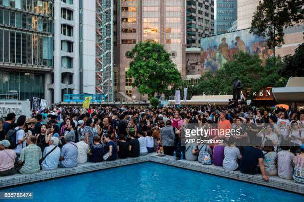 Protesters gather at Statue Square next to the Court of Final Appeal after a march in Hong Kong on August 20 to protest the jailing of Joshua Wong...