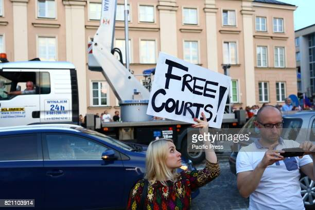 Protesters gather at supreme court in Warsaw to demand for Presidential veto against new law court reforms People shout for veto and light up...