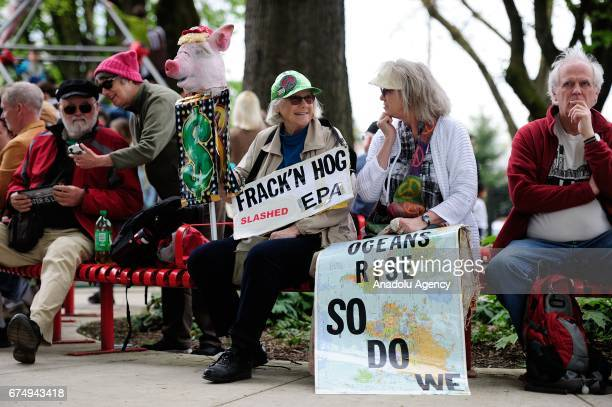 Protesters gather before taking part in the People's Climate March in Portland Ore United States on April 29 2017 Thousands turned out in solidarity...