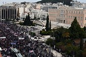 Protesters gather beside the Greek parliament during a massive protest on February 4 2016 Thousands of people marched across Greece on February 4...