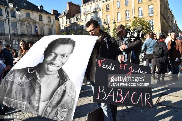 Protesters gather during a demonstration against police brutality on February 18 2017 in Rennes following the alleged rape in the Paris suburb of...