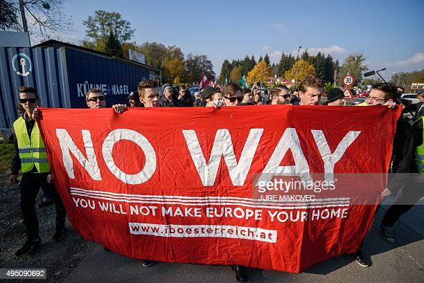 Protesters gather during an antimigrants rally in Spielfeld Austria near the AustriaSlovenia border on October 31 2015 Austria's interior minister...