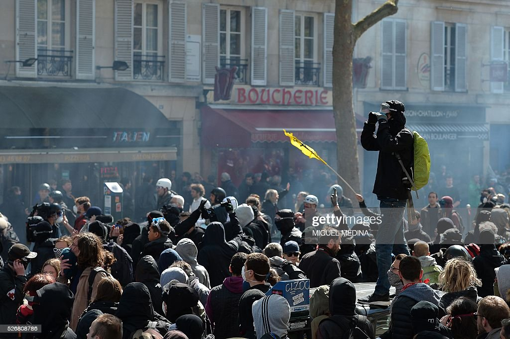 Protesters gather during clashes with police at a traditional May Day demonstration on May 1, 2016, in Paris.