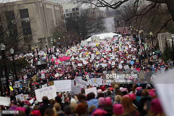 Protesters gather during the Women's March on Washington January 21 2017 in Washington DC The march is expected to draw thousands from across the...