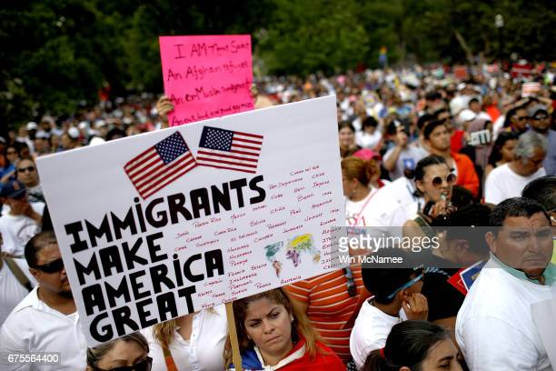 Protesters gather for a demonstration in Lafayette Park to denounce US President Donald Trump's antiimmigrant policies May 1 2017 in Washington DC...
