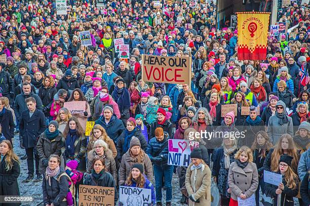 Protesters gather for the Women's March in Oslo Norway January 21 2017 The march is being held in solidarity with similar events taking place...