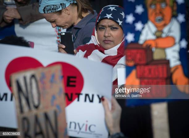 TOPSHOT Protesters gather in Battery Park and march to the offices of Customs and Border Patrol in Manhattan to protest President Trump's Executive...
