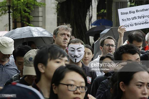 Protesters gather in Charter Garden at the start of the protest rally to support Edward Snowden in Hong Kong on June 15 2013 in Hong Kong Hong Kong...