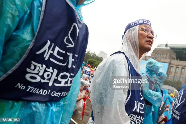 Protesters gather in front of city hall during a rally against the deployment of the Terminal HighAltitude Area Defense system in Seoul South Korea...