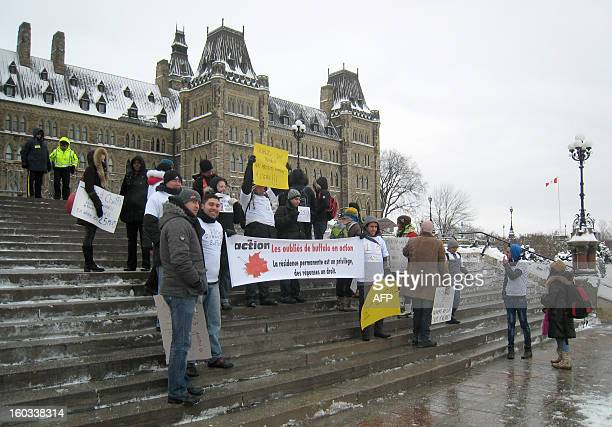 Protesters gather in front of the Canadian parliament in Ottawa on January 29 2013 as thousands of immigrants pressed Canada's government to...