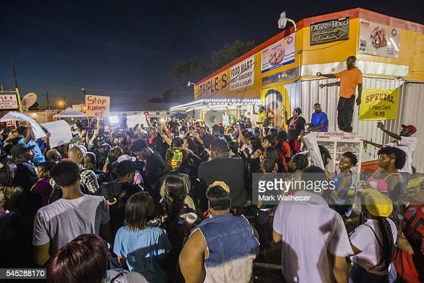 protesters gather in front of the convenience store where Alton Sterling was shot and killed July 6 2016 in Baton Rouge Louisiana Sterling was shot...