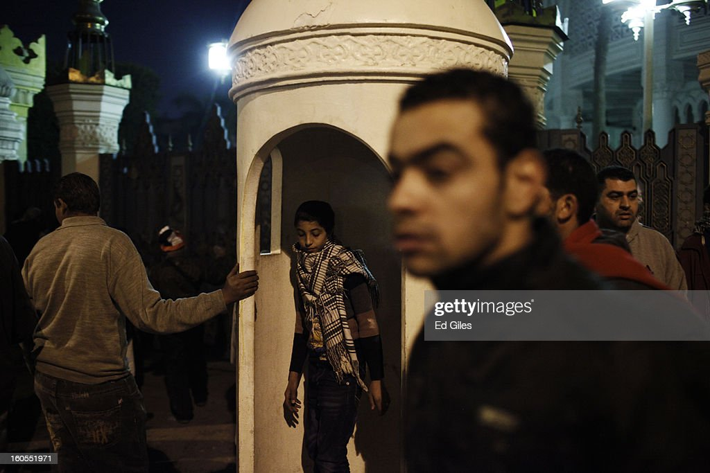 Protesters gather in front of the gates of the Egyptian Presidential Palace during a demonstration following the commemoration march for a protester, killed during clashes with Egyptian security forces the previous night, on February 2, 2013 in Cairo, Egypt. 23-year old protester Mohammed Hussein Korani was killed after sustaining gunshot wounds to the neck and chest during fighting with riot police outside Egypt's Presidential Palace in Cairo late on the night of February 1. Protests continued across Egypt nearly one week after the second anniversary of the Egyptian Revolution that overthrew former President Hosni Mubarak on January 25, 2011.(Photo by Ed Giles/Getty Images).