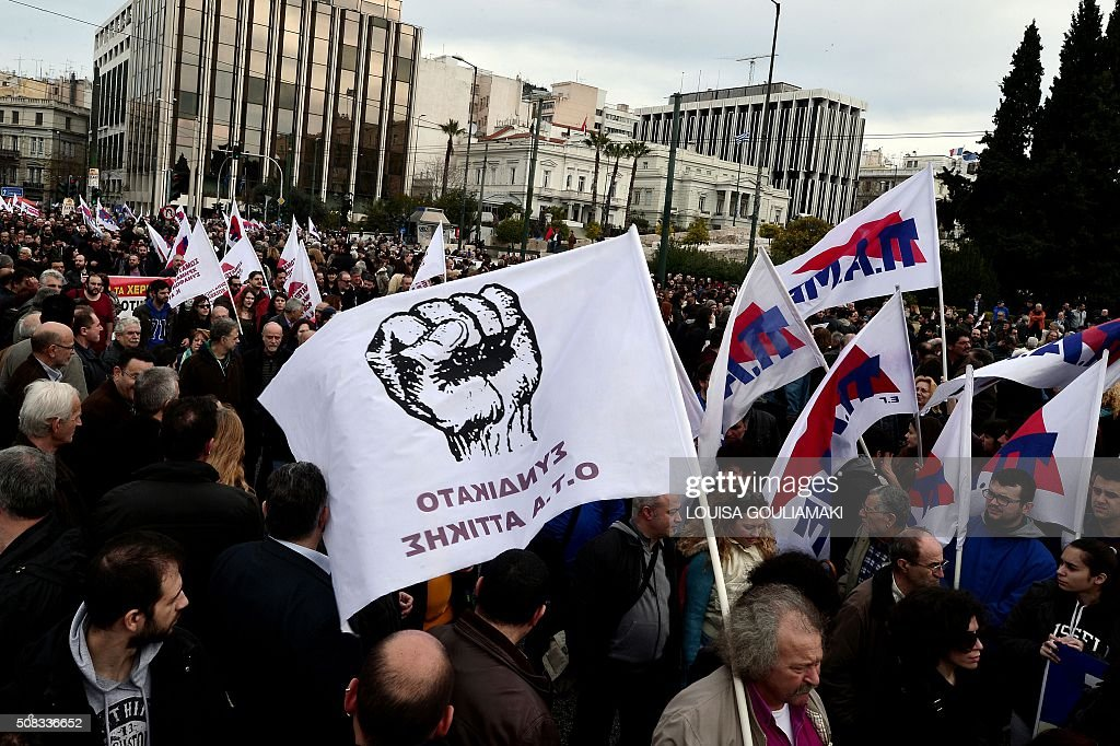 TOPSHOT - Protesters gather in front of the Greek parliament in Athens during a massive protest rally on February 4, 2016. Thousands of people marched across Greece on February 4, 2016 as diverse classes united in a crippling general strike over a pension overhaul that has sparked a major backlash against embattled leftist Prime Minister Alexis Tsipras. / AFP / LOUISA