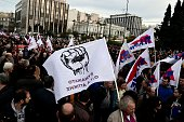 TOPSHOT Protesters gather in front of the Greek parliament in Athens during a massive protest rally on February 4 2016 Thousands of people marched...