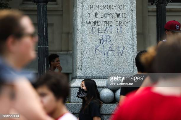 Protesters gather in front of the old Durham County Courthouse where days earlier a confederate statue was toppled by demonstrators in Durham North...