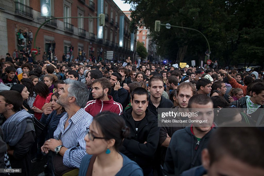 Protesters gather in Neptuno Square during demonstrations surrounding the Spanish Parliament on September 25, 2012 in Madrid, Spain. Demonstrators from various organizations, demanding a new constitutional process, are marching today from three different locations in the center of Madrid to the lower house in the Spanish parliament.
