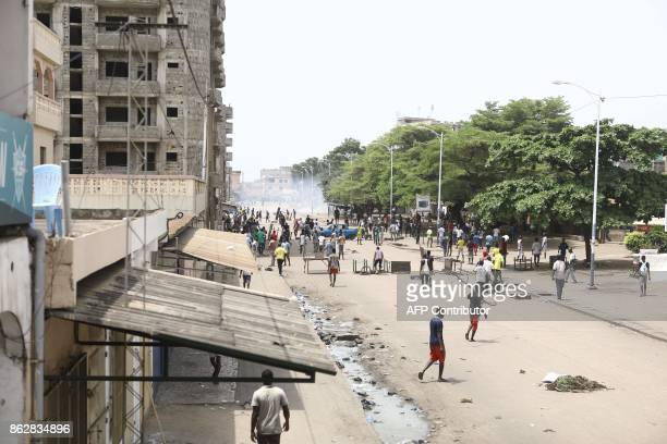 Protesters gather in the streets where opposition supporters erect makeshift barricades and block roads in Lome on October 18 2017 Protesters erected...