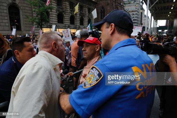Protesters gather near Trump Tower during a demonstration against attacks on immigrants under the policies of US President Donald Trump August 15...