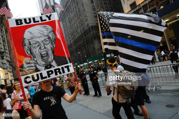 Protesters gather near Trump Tower to protest against attacks on immigrants under policies of US President Donald Trump August 15 2017 in New York /...