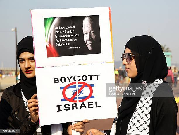 Protesters gather on July 12 2014 with a placard in front of North Beach in Durban calling on South African President Jacob Zuma to boycott Israel...