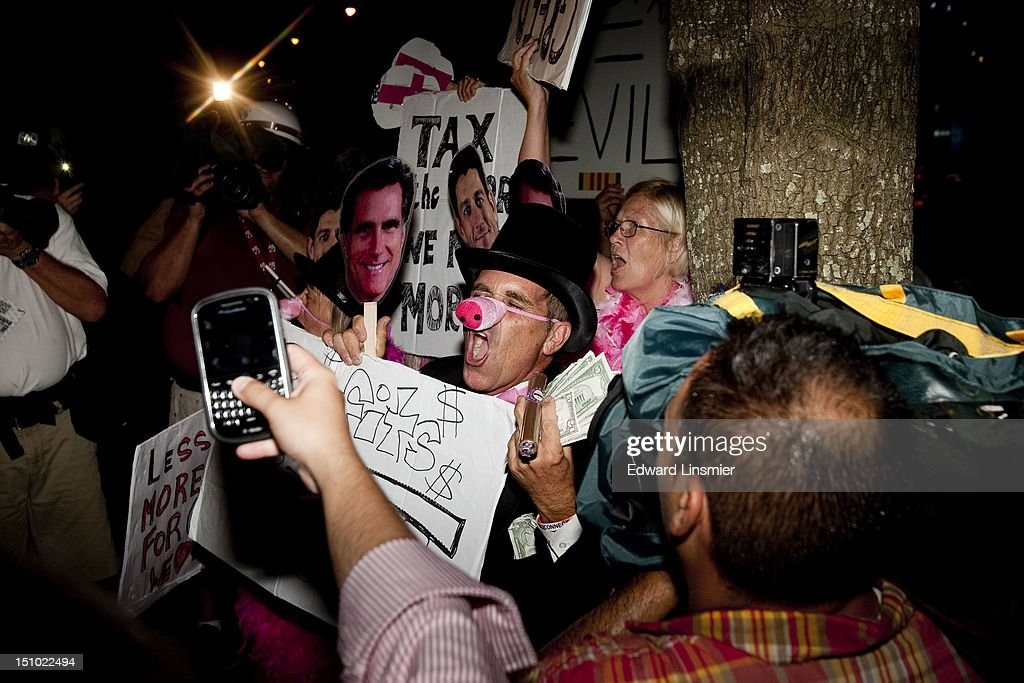 Protesters gather on the last night of the Republican National Convention in Tampa, Florida on August 30, 2012. The Republican party delegates affirmed Mitt Romney as the party's nominee for president August 28.