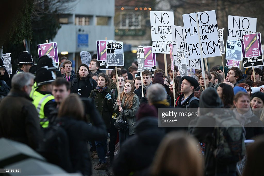Protesters gather outside Cambridge University's Student Union as Marine Le Pen, the leader of the French far-right 'Front National' party, addresses the Union's debating society on February 19, 2013 in Cambridge, England. Mrs Le Pen, who has been an MEP since 2004 and is the daughter of former Front National leader Jean Marie Le Pen, is expected to speak about the future of the European Union and French politics. Although her appearance at the Union has provoked controversy with the anti-fascist group 'Unite Against Fascism'.