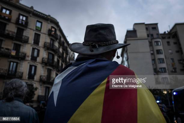Protesters gather outside the building that houses the representation of the Spanish government to demonstrate against the pending triggering of...