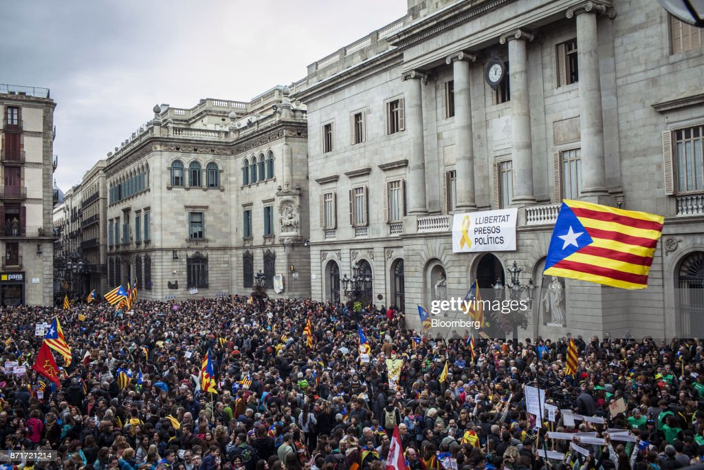 Protesters gather outside the Generalitat regional government offices in Sant Jaume square calling for 'Freedom for political prisoners' during a regional strike called by pro-independence union in Barcelona, Spain, on Wednesday, Nov. 8, 2017. Spanish Prime MinisterMariano Rajoyinvoked extraordinary powers last month to reassert his authority over Catalonia and fire Catalan presidentCarles Puigdemont and his government.Photographer: Angel Garcia/Bloomberg via Getty Images