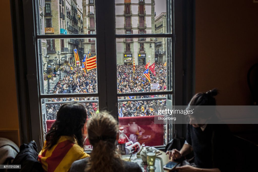 Protesters gather outside the Generalitat regional government offices in Sant Jaume square during a regional strike called by pro-independence union in Barcelona, Spain, on Wednesday, Nov. 8, 2017. Spanish Prime MinisterMariano Rajoyinvoked extraordinary powers last month to reassert his authority over Catalonia and fire Catalan presidentCarles Puigdemont and his government.Photographer: Angel Garcia/Bloomberg via Getty Images