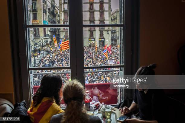Protesters gather outside the Generalitat regional government offices in Sant Jaume square during a regional strike called by proindependence union...