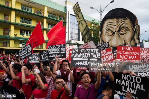 Protesters gather outside the House of Representatives in Quezon City where Philippine President Rodrigo Duterte delivered his second state of the...