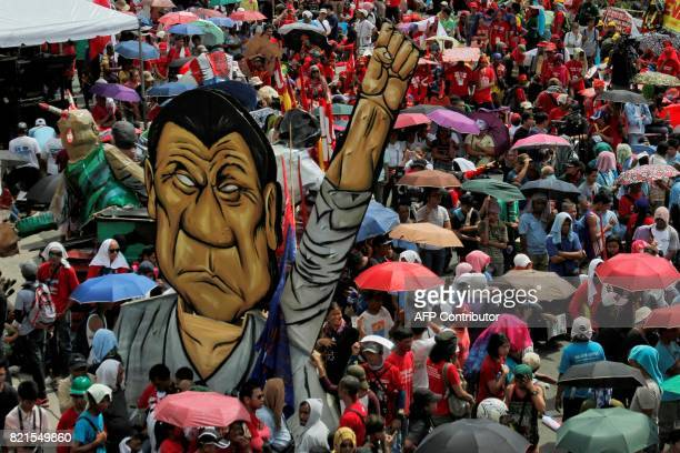 Protesters gather outside the House of Representatives where Philippine President Rodrigo Duterte's state of the nation address is taking place in...