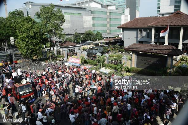 Protesters gather outside the Indonesian Supreme Court building in Jakarta on May 12 to demand the release of Jakarta's governor Basuki Tjahaja...