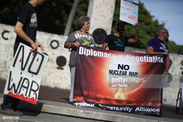 Protesters gather to ask President Donald Trump to stop his drive to war against North Korea on August 14 2017 in Miami Florida The protesters feel...