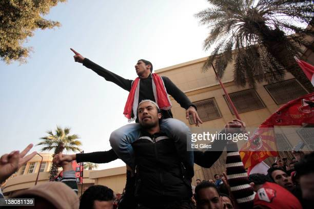 Protesters gather to demonstrate outside Cairo's Al Ahly football stadium on February 2 2012 in Cairo Egypt The protest follows the deaths of 74...