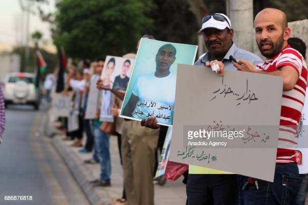 Protesters gather to stage a human chain protest in support of hunger striker Palestinian prisoners held in Israeli jails at Queen Rania street in...