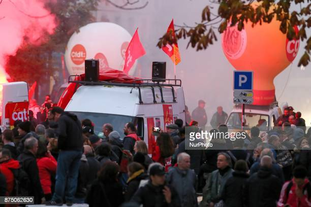Protesters gather with balloons flares and banners during a demonstration as part of a nationwide protest day against the government's economic and...